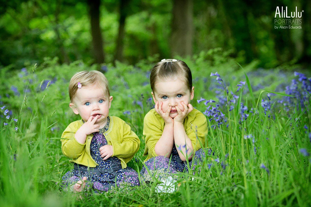 young sisters in bluebell woods
